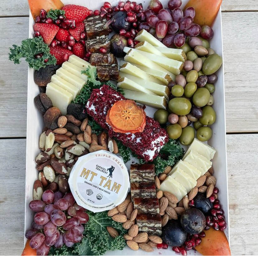Cheese plate with fruits, crackers and nuts